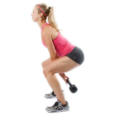 Posture: slight forward lean, back arched, head facing forward.