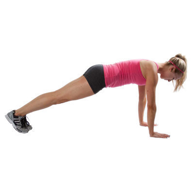 Position hands palms shoulder width apart, feet together and body in a plank position.